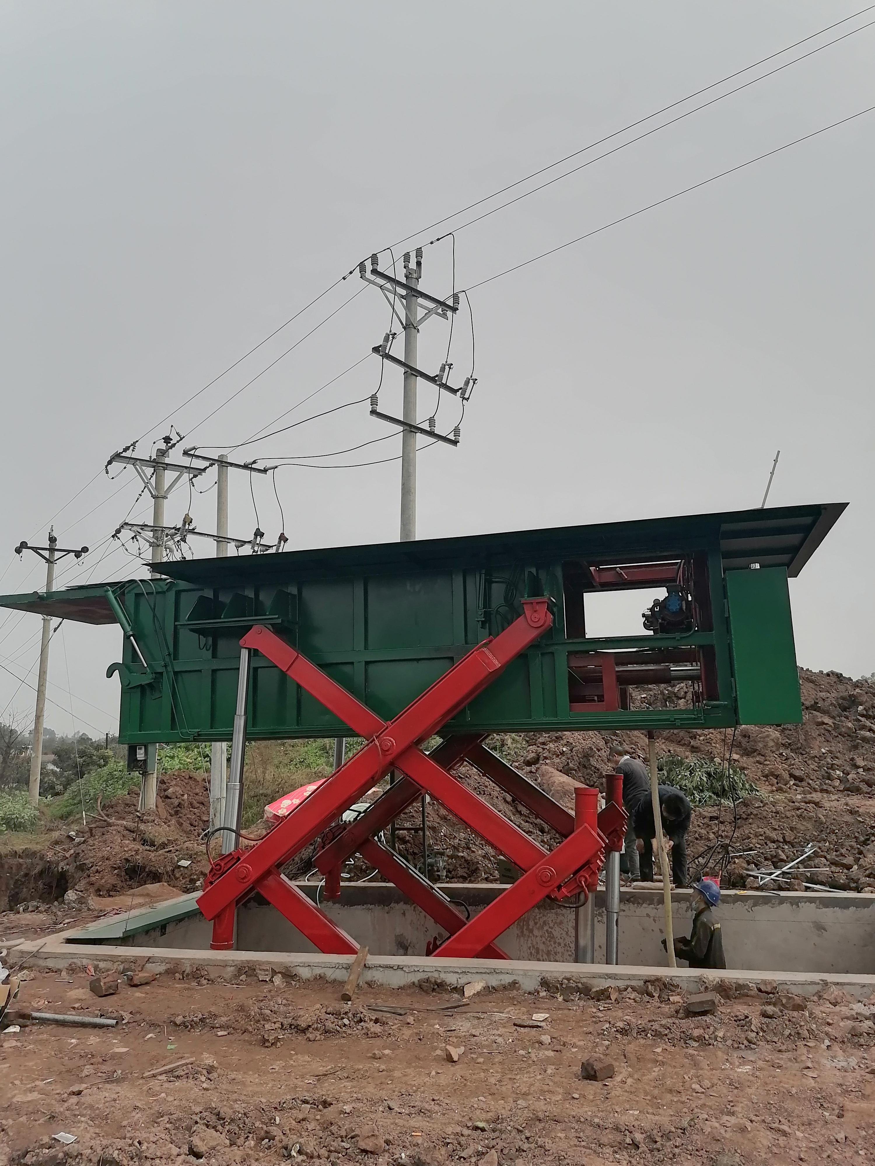 泸县水平压缩地埋式垃圾站正式投入使用/泸州得力液压厂家提供